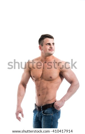 Sexy smiling shirtless male model with muscular body and abs against isolated white background looking to the camera