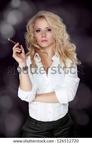 Sexy smoking beautiful woman cigar closeup studio shot - stock photo