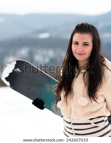sexy snowboarder on snow - stock photo