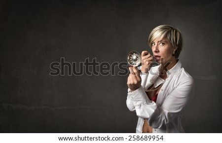 sexy sommelier make up herself with tastevin - stock photo