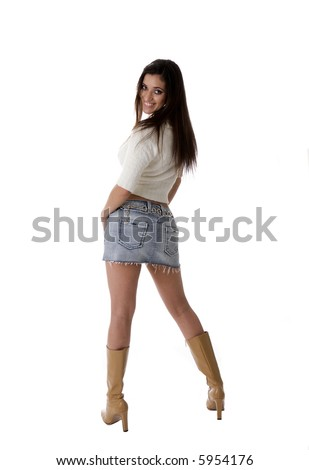 Sexy Spanish woman in mini skirt with boots, isolated on white