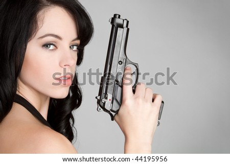 Sexy Spy with Gun - stock photo
