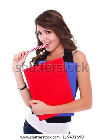 Sexy student girl with lollipop and booklets in hand - stock photo