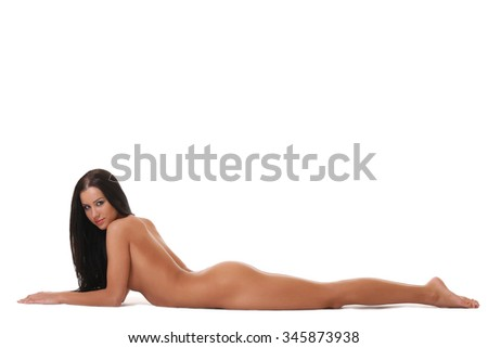 Sexy tanned naked girl lying on white - stock photo