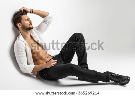 Sexy undressed male model posing  - stock photo