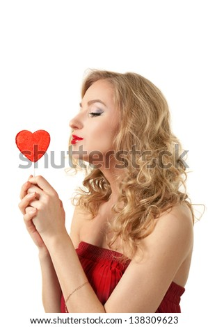 Sexy valentine girl holding heart candy