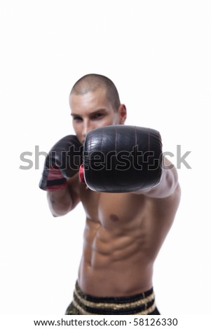 Sexy well trained male with muay thai gloves - stock photo