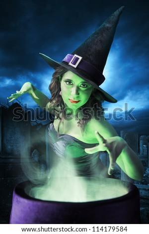 Sexy witch on a dark background - stock photo