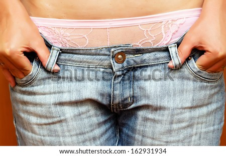 sexy woman body in blue jeans - stock photo