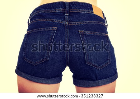 Sexy woman body in jeans shorts.