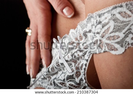 Sexy woman body lingerie on black background - stock photo