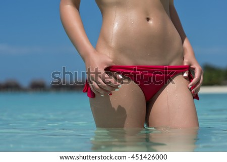 Sexy woman body on the beach background
