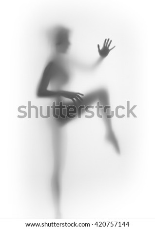 Sexy woman body silhouette behind a curtain, legs and hands