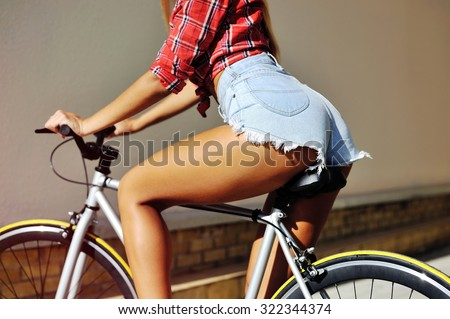 Sexy woman butt on a bicycle - close up - stock photo