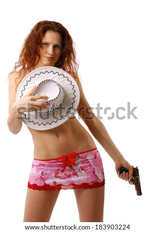 Sexy woman closes her breast with a white hat and pulls down gun. She is wearing a very short skirt and a top decorated red bowls.  - stock photo