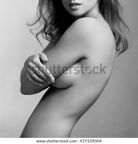 sexy woman covers her breast. perfect nude body girl - stock photo