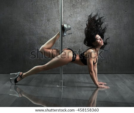 Sexy woman dance in a studio - stock photo