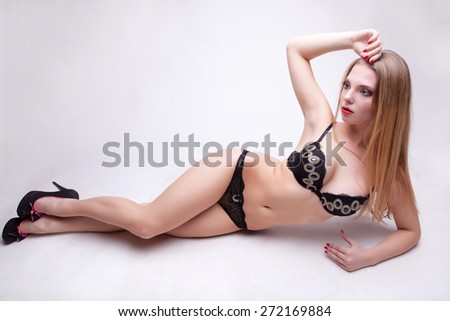 Sexy woman full body in ligerie on grey background. Studio shooting - stock photo