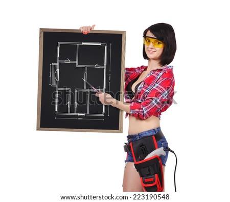 sexy woman handyman holding blackboard with blueprint - stock photo