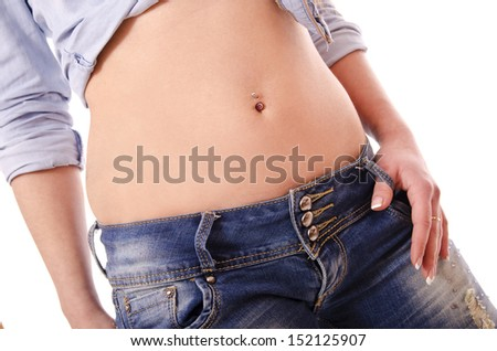 Sexy woman hip with piercing and jeans