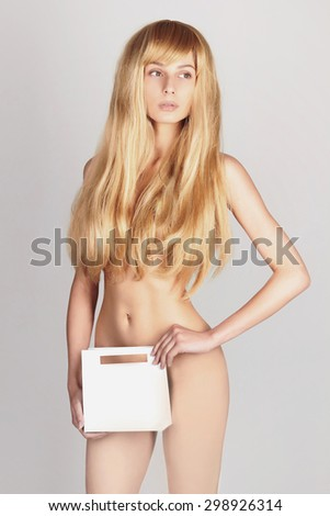 sexy woman holding shopping paper bag.Sale.Beautiful naked girl with healthy hair - stock photo