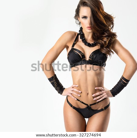 Sexy woman in a black lingerie on the white background - stock photo