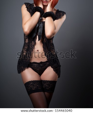 sexy woman in a black peignoir
