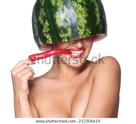 Sexy woman in a helmet of watermelon on his head. Chili pepper in his mouth. On an isolated white background. - stock photo