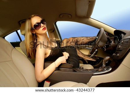 Sexy woman in a luxury car