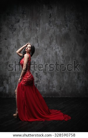 Sexy woman in a red dress