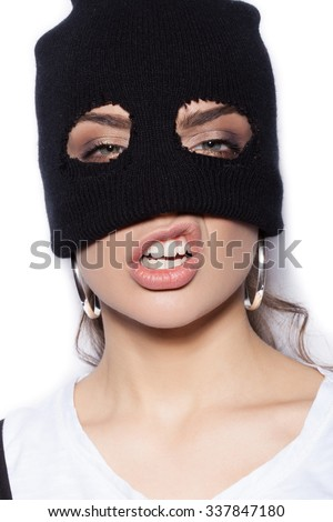 sexy woman in balaclava - crime and violence on white background not isolated