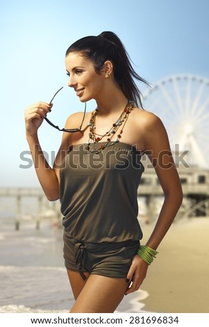Sexy woman in beachwear on the beach at summertime. - stock photo