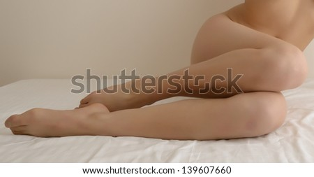 Sexy woman In bedroom - stock photo