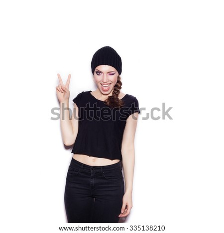 Sexy woman in black clothes having fun. Portrait of expressive girl on white background not isolated  - stock photo