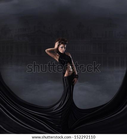 Sexy woman in black dress - stock photo