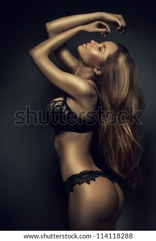sexy woman in black lingerie with long hair - stock photo