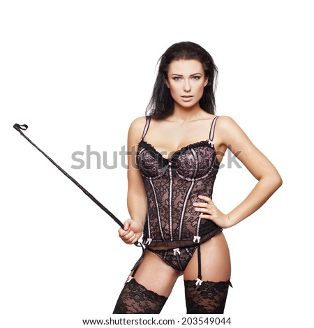 Sexy woman in corset, panties and whip, isolated on white - stock photo