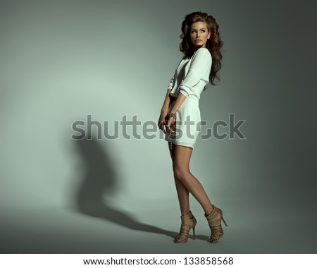 Sexy woman in dress on green background - stock photo