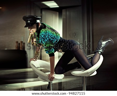 Sexy woman in fashionable interior - stock photo