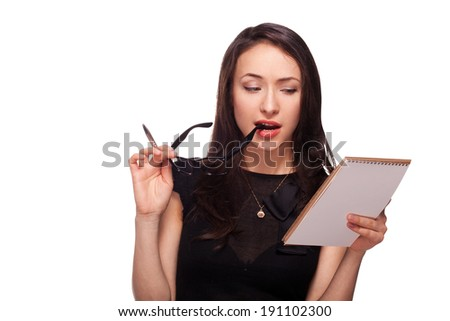 Sexy woman in glasses with notepad - stock photo