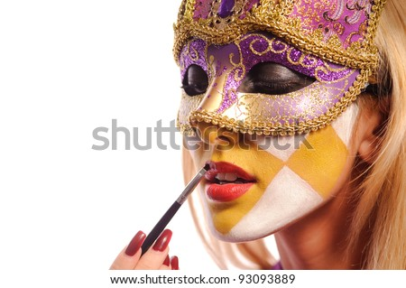 sexy woman in half mask from Venice brush her lips, isolated on white. may be use for fashion make-up concept - stock photo
