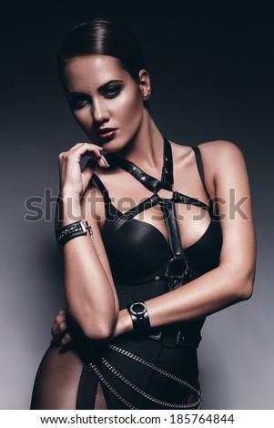 sexy woman in leather bandage - stock photo
