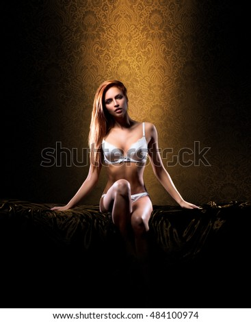 Sexy woman in lingerie over yellow retro background