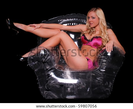 Sexy Woman in Lingerie sitting in a Clear Bubble Chair - stock photo