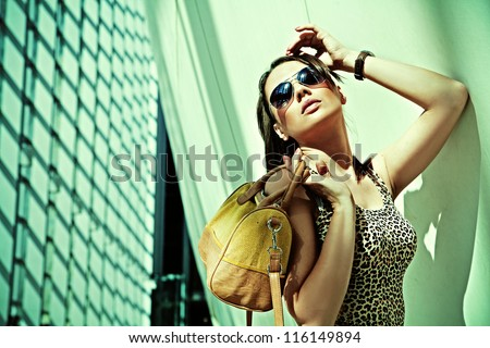 Sexy woman in modern interior - stock photo