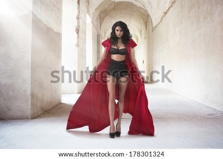 Sexy woman in red coat - stock photo
