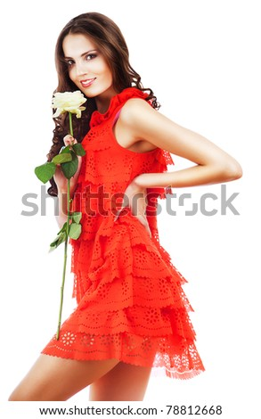 sexy woman in red dress with big white rose on white background