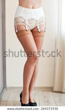 Sexy woman in retro style suspenders - stock photo