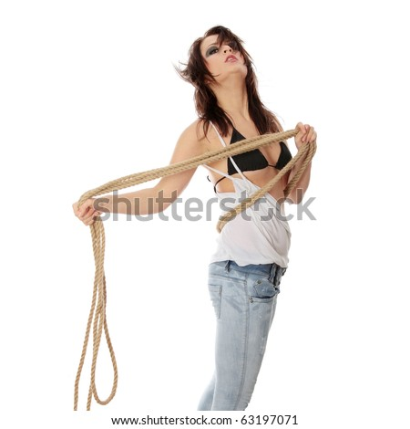 Sexy woman in rock style clothing against white background - stock photo