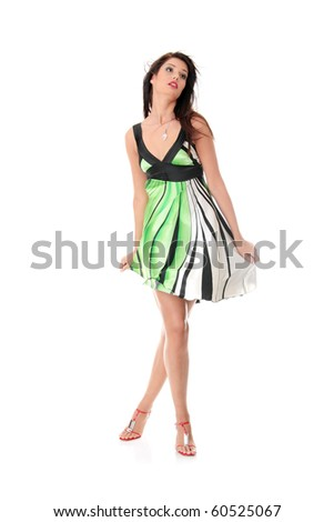 Sexy woman in skirt blown by wind, isolated on white background - stock photo